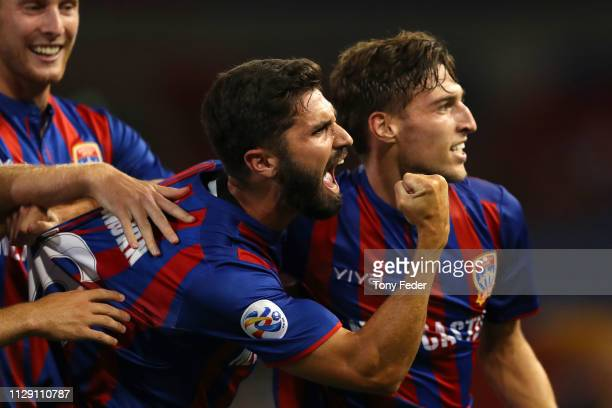 Nick Cowburn of the Newcastle Jets celebrates with team mate Matthew Ridenton during the AFC Champions League Second Round Preliminary Stage match...