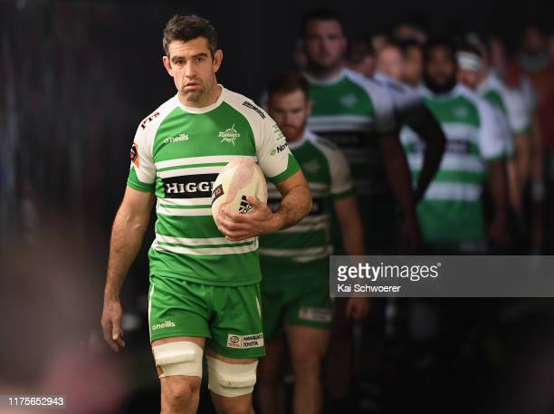 Nick Crosswell of Manawatu leads his team onto the field for his 100th Mitre 10 Cup match during the round 7 Mitre 10 Cup match between Canterbury...