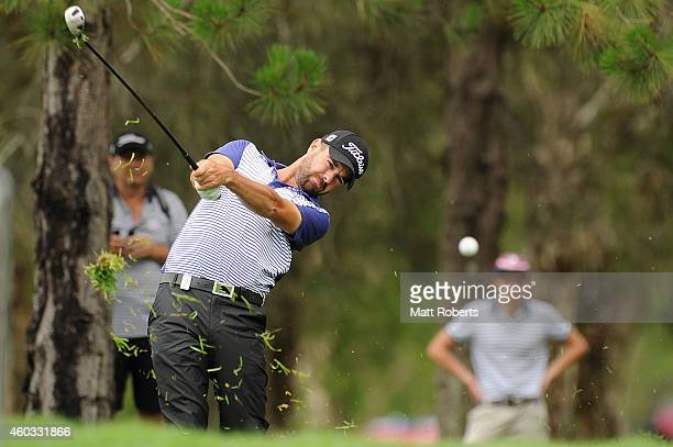 Nick Cullen of Australia hits out of the rough on the 3rd hole during day two of the 2014 Australian PGA Championship at Royal Pines Resort on...