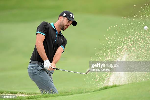 Nick Cullen of Australia plays a shot out of the bunker on the 3rd hole during day three of the 2014 Australian PGA Championship at Royal Pines...