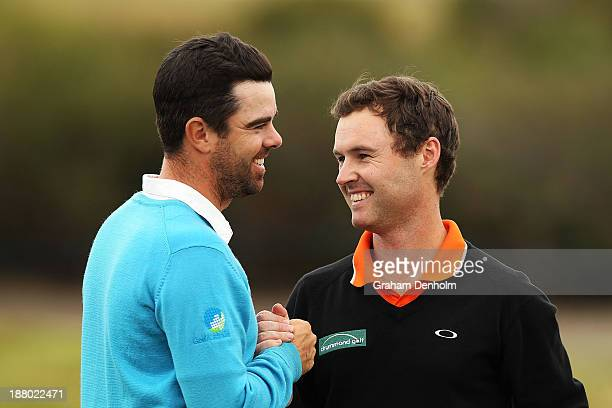 Nick Cullen of South Australia and Matthew Griffin of Victoria shake hands following their round during round two of the 2013 Australian Masters at...