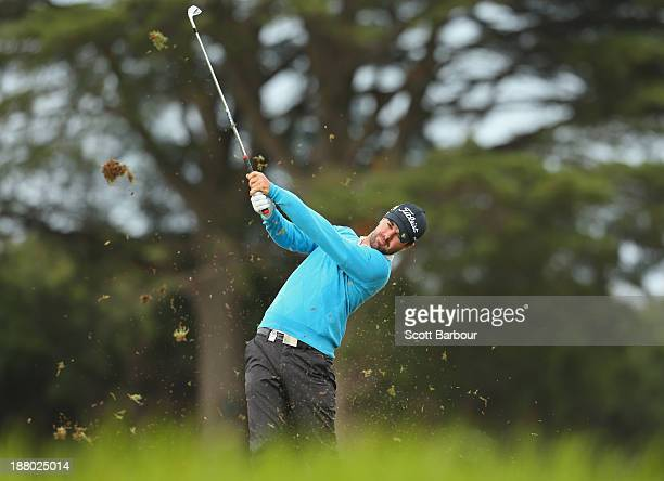Nick Cullen of South Australia plays an approach shot on the 17th hole during round two of the 2013 Australian Masters at Royal Melbourne Golf Course...