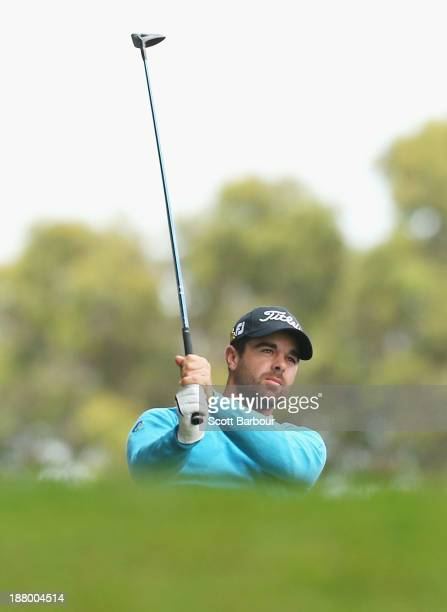 Nick Cullen of South Australia tees off on the 12th hole during round two of the 2013 Australian Masters at Royal Melbourne Golf Course on November...