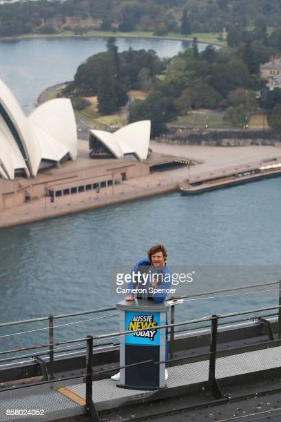 Nick Cummins delivers the first news bulletin for Aussie News Today from the top of the Sydney Harbour Bridge on October 6 2017 in Sydney Australia
