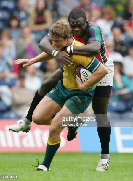 Nick Cummins of Australia battles with Victor Sudi Simiyu Kenya during the IRB Edinburgh Sevens match between Australia and Kenya at Murrayfiled on...