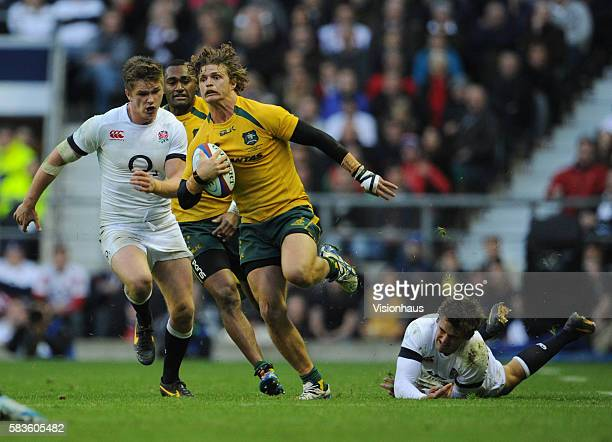 Nick Cummins of Australia escapes a tackle from Toby Flood of England as Owen Farrell chases during the QBE international match between England and...