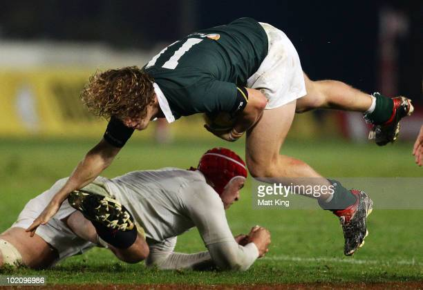 Nick Cummins of the Barbarians is tackled by Dave Attwood of England during the match between the Australian Barbarians and England at Bluetongue...