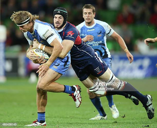 Nick Cummins of the Force is tackled by Hugh Pyle of the Rebels during the round 10 Super Rugby match between the Melbourne Rebels and the Western...