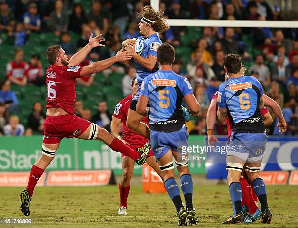 Nick Cummins of the Force takes a high catch against Curtis Browning of the Reds during the round 18 Super Rugby match between the Western Force and...