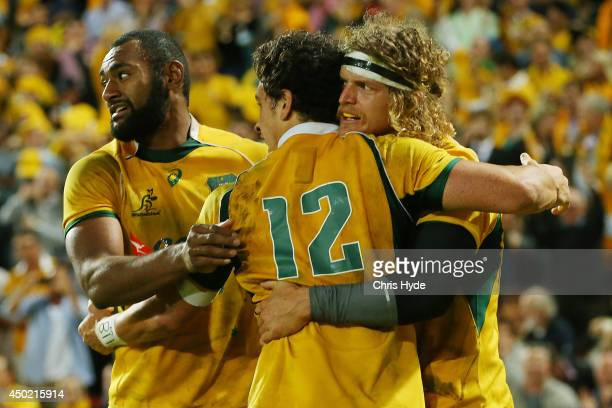 Nick Cummins of the Wallabies celebrates a try with team mates during the First International Test Match between the Australian Wallabies and France...