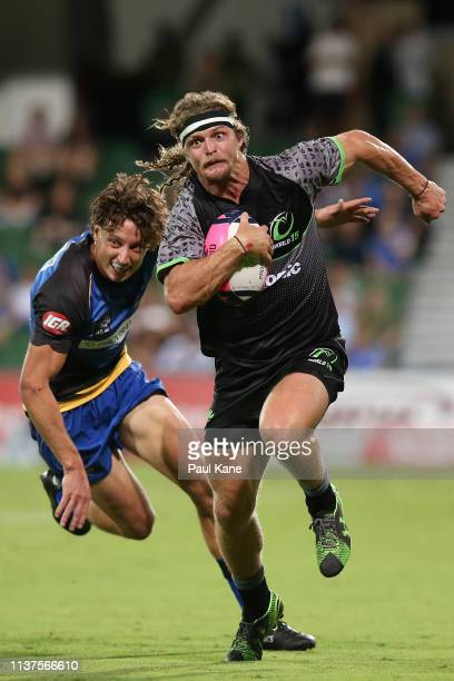 Nick Cummins of the World XV runs the ball during the Global Rapid Rugby match between the Western Force and the World XV at HBF Park on March 22...