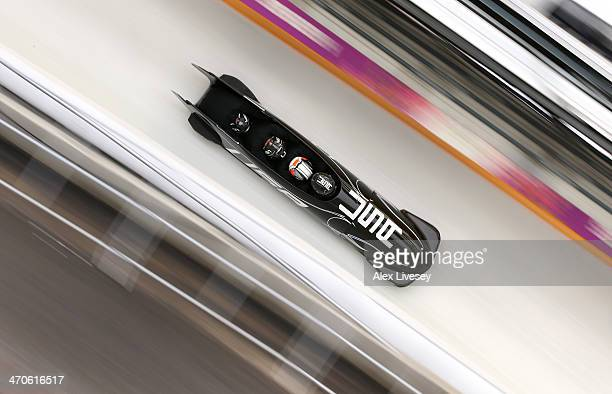 Nick Cunningham of USA pilots a run during a fourman bobsleigh practice session on Day 13 of the Sochi 2014 Winter Olympics at Sliding Center Sanki...