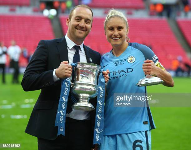 Nick Cushing manager of Manchester City and Steph Houghton of Manchester City WFC with Trophy during The SSE FA Women's CupFinal match...