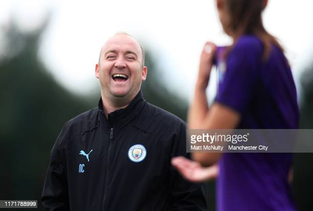 Nick Cushing manager of Manchester City shares a joke during the training session at Manchester City Football Academy on September 02 2019 in...