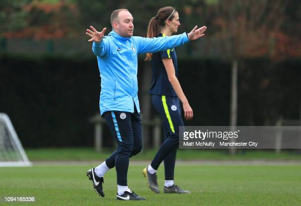 Nick Cushing manager of Manchester City shouts instructions during the training session at Manchester City Football Academy on February 5 2019 in...