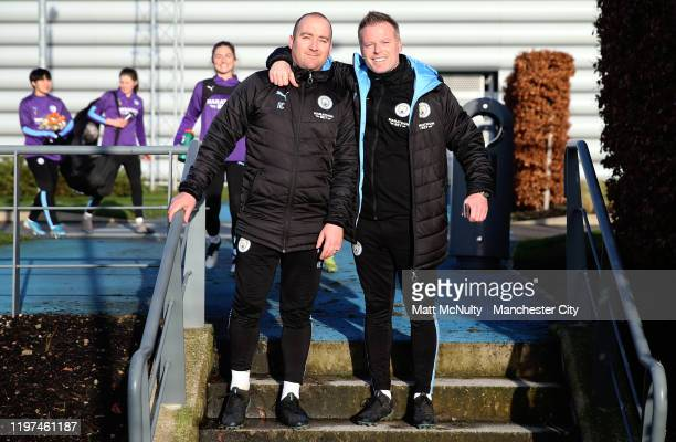 Nick Cushing Manager of Manchester City Women and Assistant Coach Alan Mahon pose for a photo during the training session at Manchester City Football...