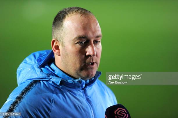 Nick Cushing Manager of Manchester City Women looks on as he is interviewed after the FA Continental Tyres Cup Semi Final match between Chelsea Women...