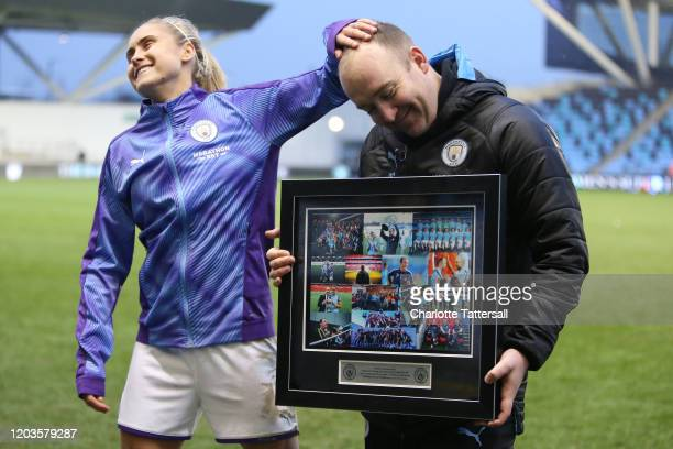 Nick Cushing manager of Manchester City Women receives gift from club as last game as manager with Steph Houghton during the Barclays FA Women's...