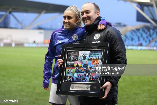 Nick Cushing manager of Manchester City Women receives gift from the club for his last game as manager with Steph Houghton after the Barclays FA...