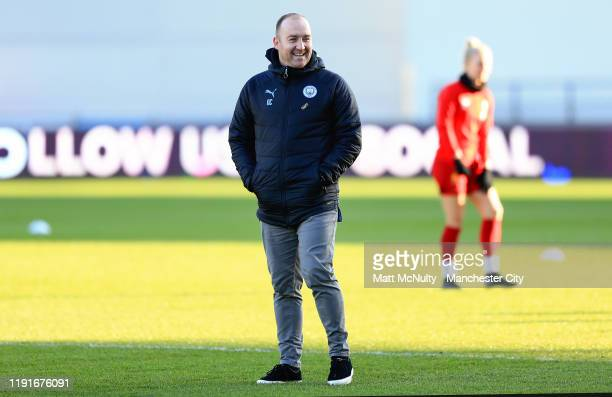 Nick Cushing manager of Manchester City Women shares a joke during the Barclays FA Women's Super League match between Manchester City and Liverpool...