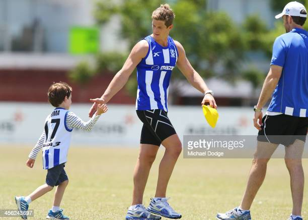 Nick Dal Santo shakes a fans hand during a North Melbourne Kangaroos AFL preseason training session at Aegis Park on December 14 2013 in Melbourne...