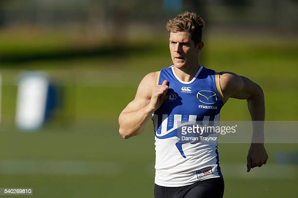 Nick Dal Santo takes part in running drills during a North Melbourne Kangaroos AFL training session at Arden Street Ground on June 15 2016 in...