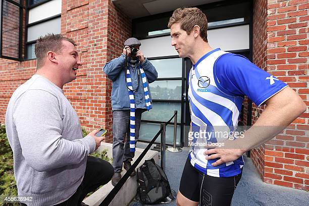 Nick Dal Santo talks to a fan during a North Melbourne Kangaroos AFL training session at Arden Street Ground on September 18 2014 in Melbourne...