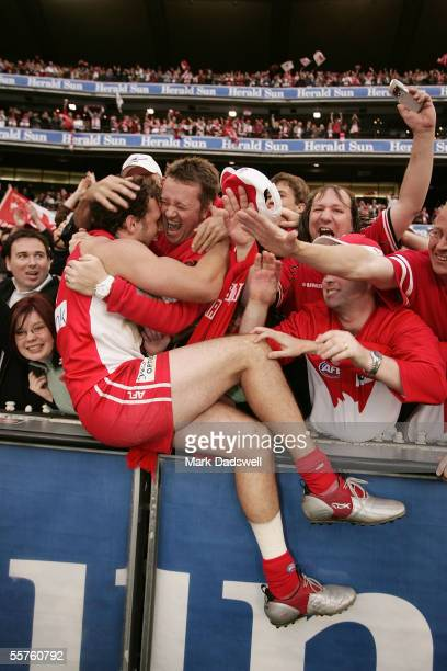 Nick Davis of the Swans celebrates victory with fans after the 2005 AFL Grand Final between the Sydney Swans and the West Coast Eagles at the...