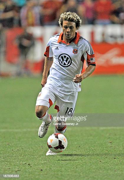 Nick DeLeon of DC United directs the ball downfield against Real Salt Lake during the 2013 US Open Cup Final at Rio Tinto Stadium October 1 2013 in...