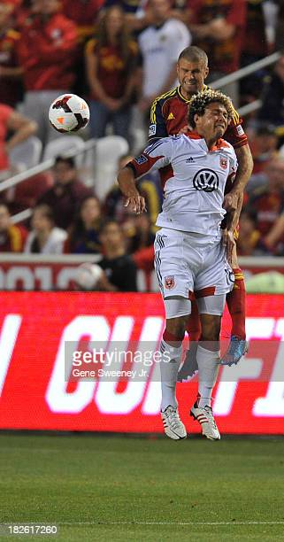 Nick DeLeon of DC United heads the ball away from Chris Wingert of Real Salt Lake at Rio Tinto Stadium October 1 2013 in Sandy Utah