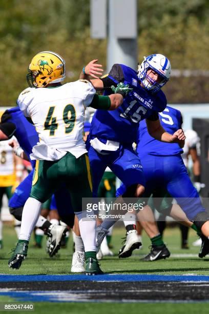 Nick DeLuca inside defensive linebacker North Dakota State University Bison pushes Cade Sparks quarterback Indiana State University Sycamores in a...