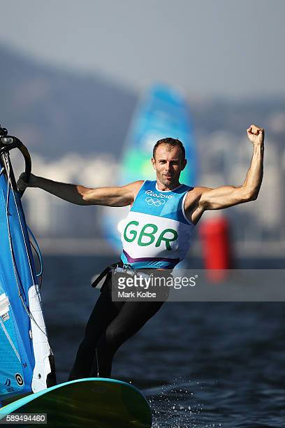 Nick Dempsey of Great Britain celebrates claiming second place overall in the Men's RSX class on Day 9 of the Rio 2016 Olympic Games at the Marina da...
