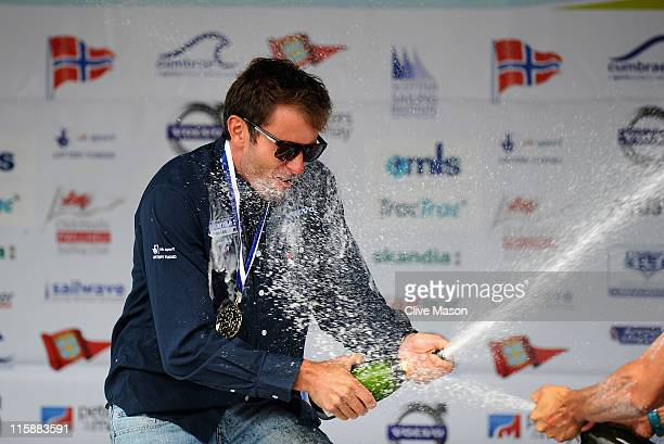 Nick Dempsey of Great Britain celebrates his gold medal in the RSX class medal race on day six of the Skandia Sail for Gold Regatta at the Wemouth...