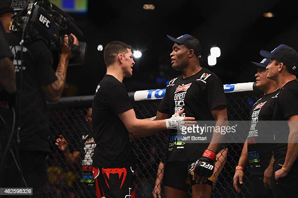 Nick Diaz and Anderson Silva speak after their middleweight bout during the UFC 183 event at the MGM Grand Garden Arena on January 31 2015 in Las...