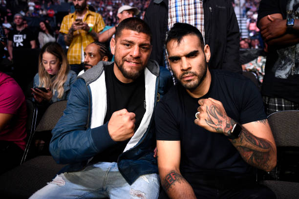Nick Diaz and guest Martin Sano are seen attending the UFC 261 event at VyStar Veterans Memorial Arena on April 24, 2021 in Jacksonville, Florida.