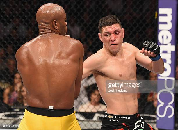 Nick Diaz punches Anderson Silva of Brazil in their middleweight bout during the UFC 183 event at the MGM Grand Garden Arena on January 31 2015 in...