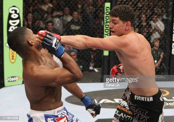 Nick Diaz punches Paul Daley during the welterweight championship bout at the Strikeforce event at the Valley View Casino Center on April 9, 2011 in...