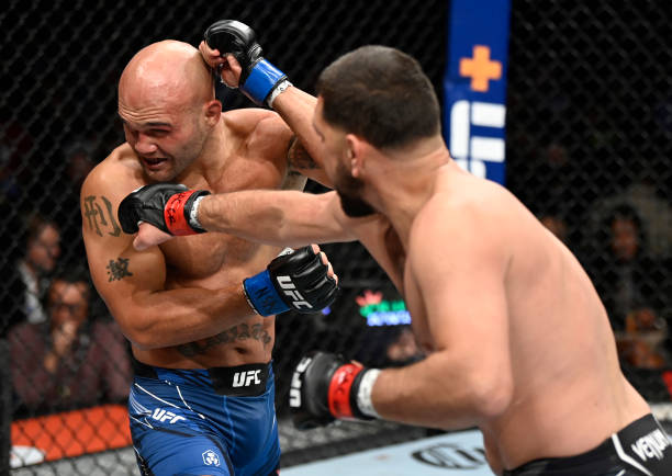 Nick Diaz punches Robbie Lawler in their middleweight fight during the UFC 266 event on September 25, 2021 in Las Vegas, Nevada.