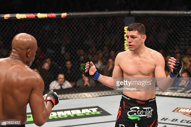 Nick Diaz taunts Anderson Silva of Brazil in their middleweight bout during the UFC 183 event at the MGM Grand Garden Arena on January 31 2015 in Las...