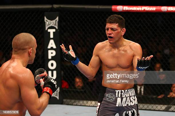 Nick Diaz taunts Georges StPierre in their welterweight championship bout during the UFC 158 event at Bell Centre on March 16 2013 in Montreal Quebec...