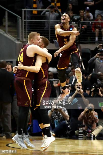 Nick Dinardi Bruno Skokna and Marques Townes of the Loyola Ramblers celebrate after defeating the Kansas State Wildcats during the 2018 NCAA Men's...