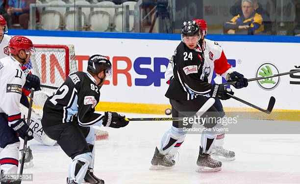 Nick Dineen of Sonderjyske Vojens tracks the puck in the air during the Champions Hockey League group stage game between Sonderjyske Vojens and IFK...