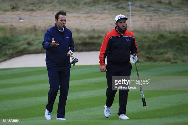 Nick Dougherty and Andrew Johnston of England demonstrate pitching in the Hero Masterclass during the third round of the British Masters at The Grove...