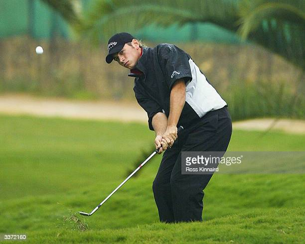 Nick Dougherty of England plays his third shot on the par five 13th hole during the first round of the Open de Seville played at the Real Club de...