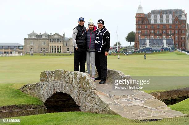 Nick Dougherty of England poses for photograph with his wife Di Dougherty and his caddie on the Swilken Bridge on the 18th hole during the second...