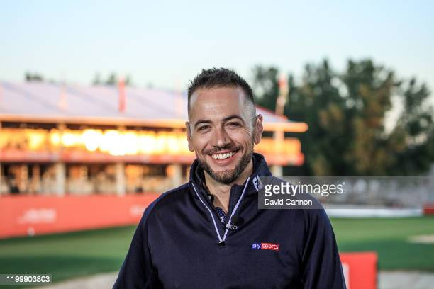 Nick Dougherty of England the former European Tour player working as the lead announcer for Sky Television during the first round of the Abu Dhabi...