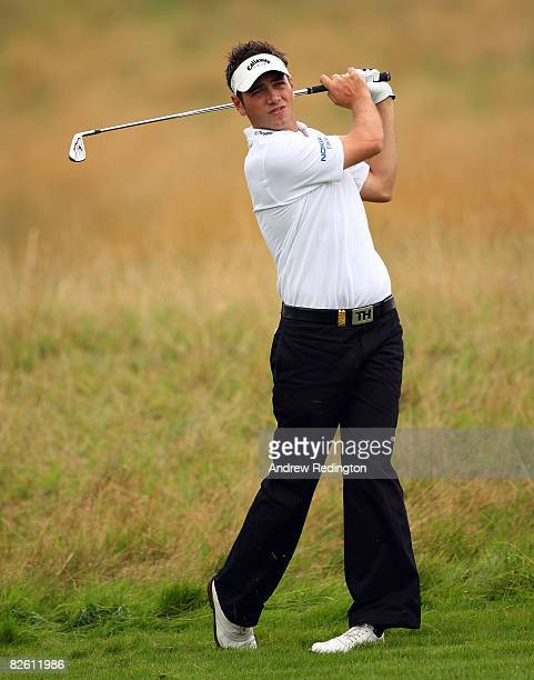 Nick Dougherty of England watches his second shot on the third hole during the final round of The Johnnie Walker Championship at Gleneagles on August...