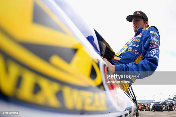 Nick Drake driver of the NAPA Auto Parts Toyota Camery gets into his car during practice for the NASCAR KN Pro Series Casey's General Stores 150 at...