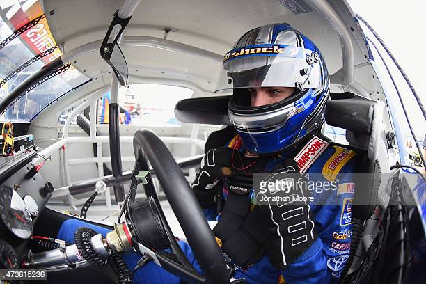 Nick Drake driver of the NAPA Auto Parts Toyota Camery sits in his car during practice for the NASCAR KN Pro Series Casey's General Stores 150 at...