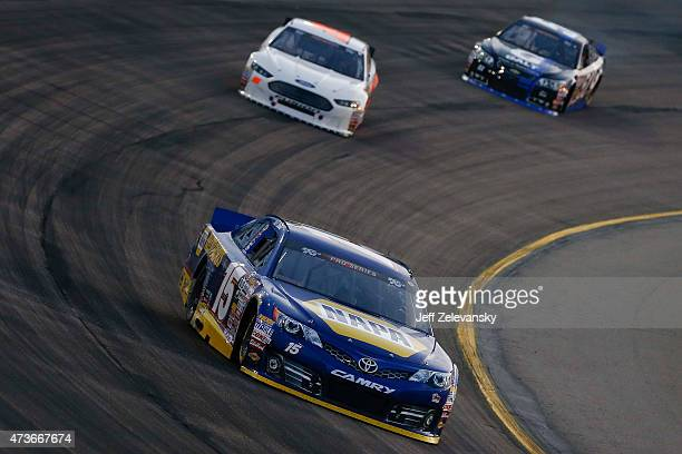 Nick Drake driver of the NAPA Auto Parts Toyota leads a pack of cars during the NASCAR KN Pro Series Casey's General Store 150 at Iowa Speedway on...